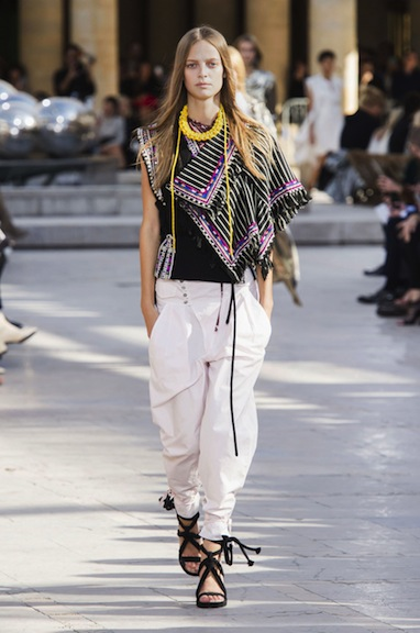 Isabel Marant's globetrotter accessories instantly update travel-friendly white pants.