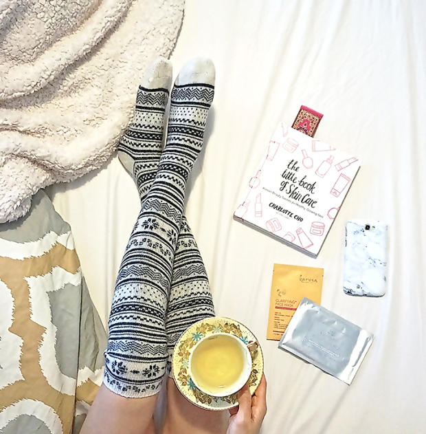 lazy day spent in bed drinking tea, reading Soko Glam's Charlotte Cho's new book on Korean skin care and doing facial sheet masks by Karuna and Le Mieux