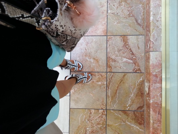from where i stand a shoefie of marble floors